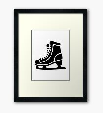 Black ice skate Framed Print