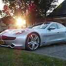 2012 Fisker Karma electric supercar against a sunset by deadadds