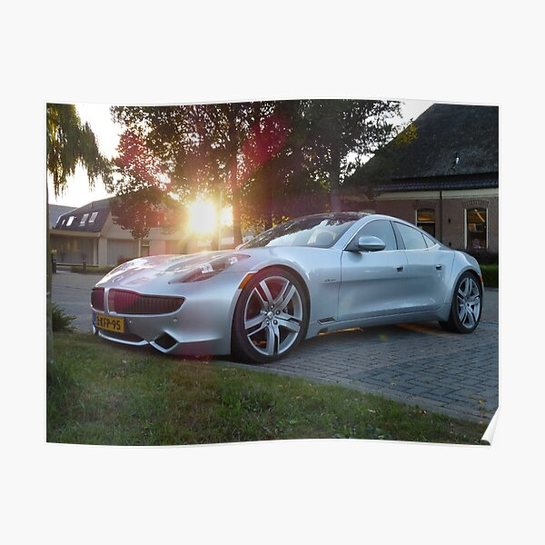 2012 Fisker Karma electric supercar against a sunset Poster