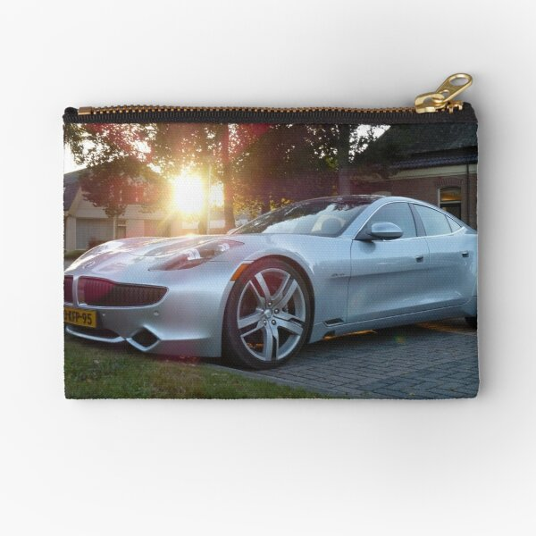 2012 Fisker Karma electric supercar against a sunset Zipper Pouch