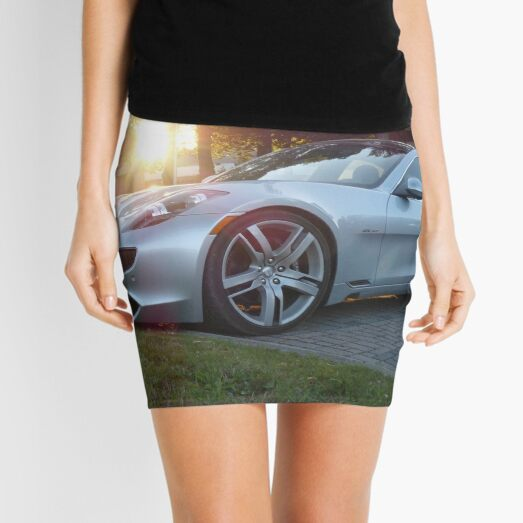 2012 Fisker Karma electric supercar against a sunset Mini Skirt