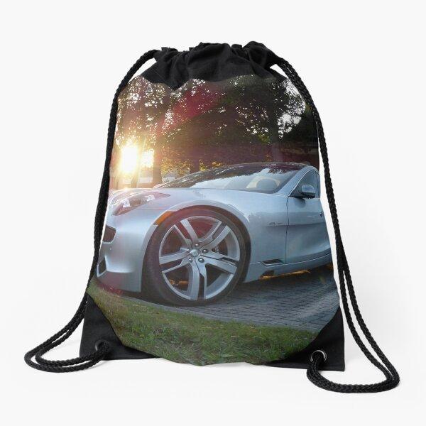 2012 Fisker Karma electric supercar against a sunset Drawstring Bag
