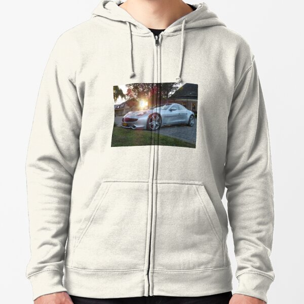 2012 Fisker Karma electric supercar against a sunset Zipped Hoodie