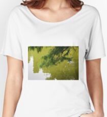 Tree branch leaning over a green lake. Women's Relaxed Fit T-Shirt