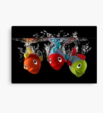 Three Toy Fish With Splash Canvas Print