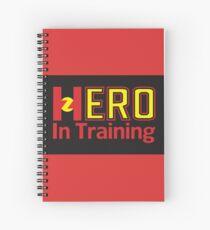 Hero In Training - Black Background Spiral Notebook