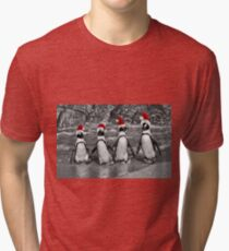 Penguins with Santa Claus caps Tri-blend T-Shirt