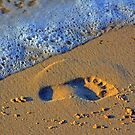 Foot Print on the beach by Remo Kurka