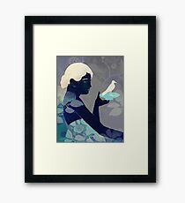 Bird on a plate Framed Print