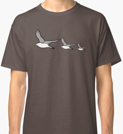 Seagulls flying like ducks on a wall Classic T-Shirt