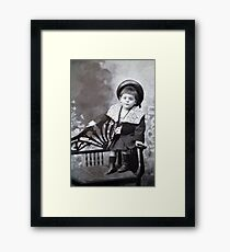 The cute little boy Framed Print