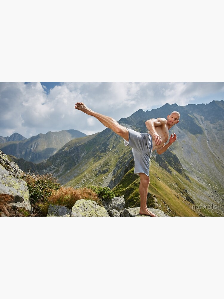 Kickboxer or muay thai fighter training on a mountain by naturalis