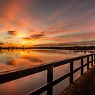 reflective sun rise by Dave  Hartley