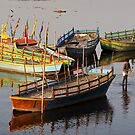 Coloured boats.  by DaveBassett
