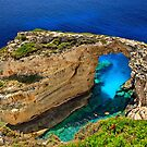 The rocky arch of Trypitos - Paxos island by Hercules Milas