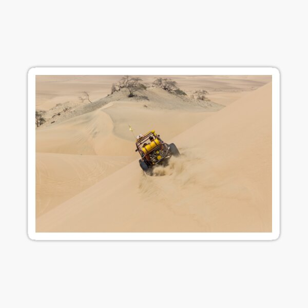 Dune buggy with passengers speeding across the side of a large dune Sticker
