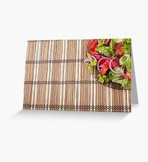 Fragment of a transparent plate of fresh vegetarian salad of raw vegetables Greeting Card
