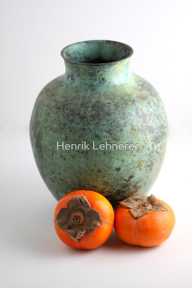 Persimmon with vase by Henrik Lehnerer