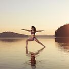 Woman practicing yoga on the water Veerabhadrasana warrior pose art photo print by ArtNudePhotos