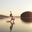 Woman practicing yoga on the water Anjaneyasana Low Lunge pose art photo print by ArtNudePhotos