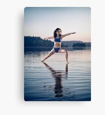 Young woman in blue swimsuit practicing yoga on the water Veerabhadrasana pose art photo print Canvas Print