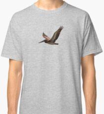 Brown pelican in flight Classic T-Shirt