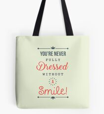 You're Never Fully Dressed Without a Smile - Be Inspired T shirt Tote Bag