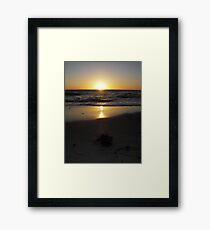 Golden glow over the horizon Framed Print