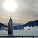 Church-tower in frozen lake by Arie Koene