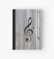 Weinlese-schwarze Musiknote dreifaches Clef graues Holz Notizbuch