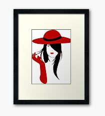 A woman with a cigarette Framed Print