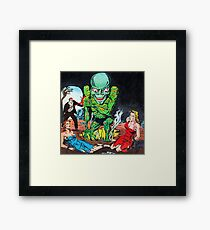 Evil Alien with his pretty captives Framed Print