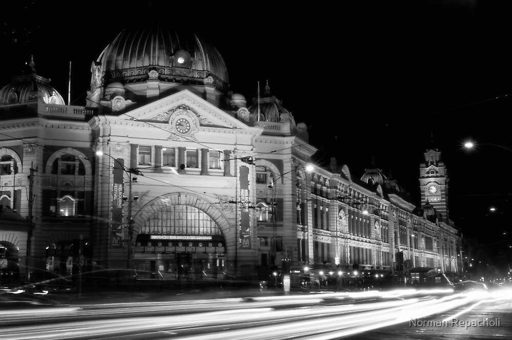Streaking past Flinders Street Station - Melbourne Australia by Norman Repacholi