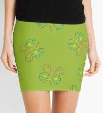 butterflies on green Mini Skirt