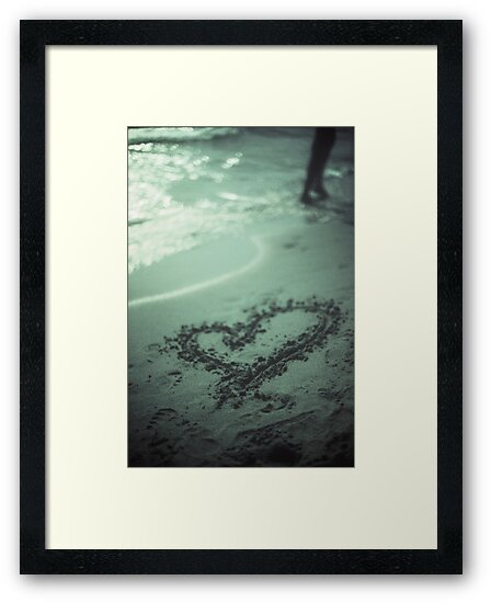 Love heart drawn on beach sand at low tide with ocean sea by edwardolive