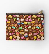 Assorted sweets colorful seamless background. Studio Pouch