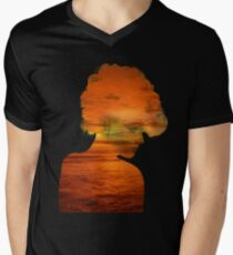 Woman immersed in the sunset.  T-Shirt