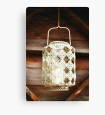 Old-fashioned lacy white lantern. Textured background. Canvas Print