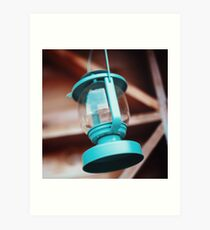 Old-fashioned blue lantern. Wooden background. Art Print