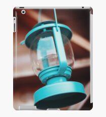 Old-fashioned blue lantern. Wooden background. iPad Case/Skin