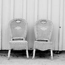 Blue and Yellow Chairs in Black and White by Larry Costales