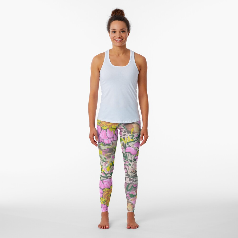 Two pink flowers on a graffiti wall Leggings