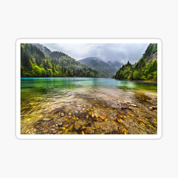 Lake in mountains, in a rainy day Sticker