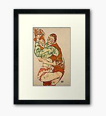 Egon Schiele - Lovemaking (1915)  Framed Print