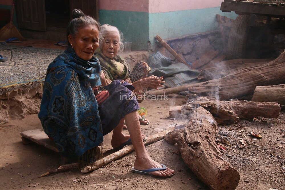Warming up, tribal village, northern Laos by indiafrank