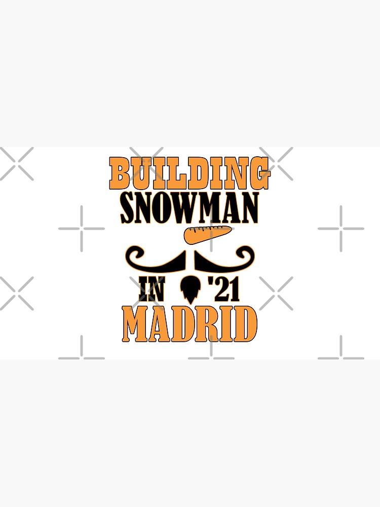 Building snowman in Madrid by CWartDesign