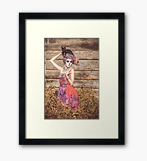 Santa Muerte halloween costume. Witch woman and black cat witch death make-up. Framed Print