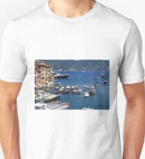 6 August 2016. Photography of the beautiful Portofino fishing village in Italy. View on small bay and colorful houses at town of Portofino in Liguria, Italy. T-Shirt