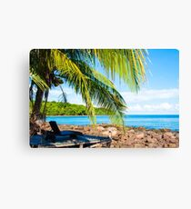 Sunbeds on exotic tropical palm beach, relax concept Canvas Print