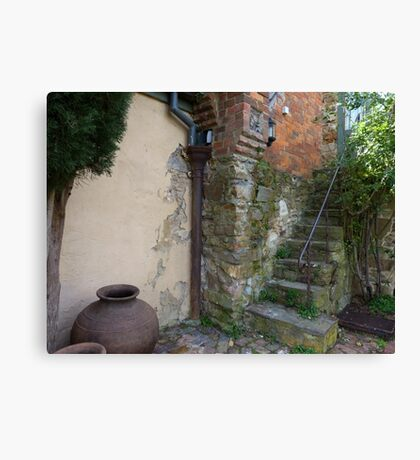 Old staircase & courtyard Canvas Print